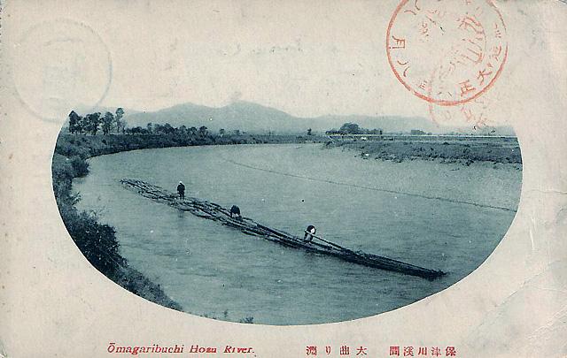 保津川・大曲り渕を行く筏